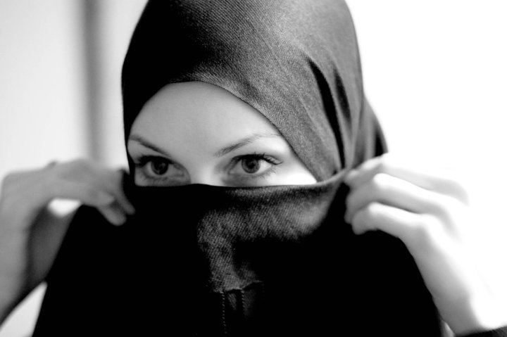 hijab - the headscarf worn by Muslim women, sometimes including a veil that covers the face except for the eyes